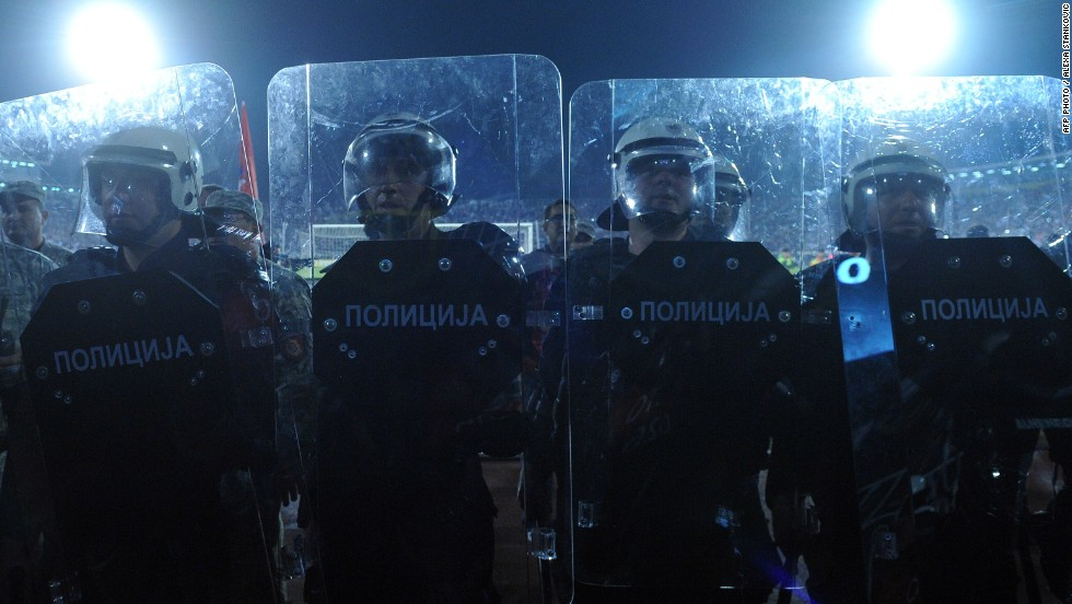 Serbian riot police officers stand guard.