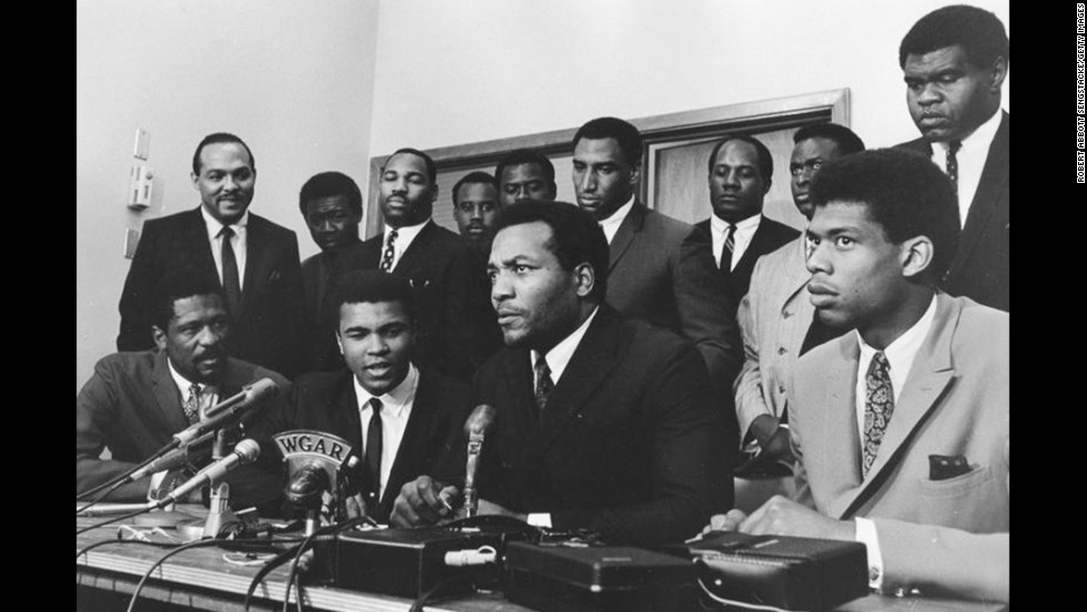 African-American athletes have a long history of speaking up in defense of civil rights. In 1967 a group of top athletes from various sports gathered to support Muhammad Ali in rejecting the draft during the Vietnam War. Seated in the front row, from left to right: Bill Russell, Ali, Jim Brown and Lew Alcindor (now Kareem Abdul-Jabbar). Standing behind them are Carl Stokes, Walter Beach, Bobby Mitchell, Sid Williams, Curtis McClinton, Willie Davis, Jim Shorter and John Wooten.