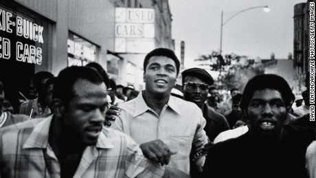 Ali walks through the streets of New York with members of the Black Panther Party in September 1970. Ali was sentenced to five years in prison and his championship title was revoked after he was convicted of draft evasion upon his refusal to serve in Vietnam as a conscientious objector in 1967. The decision was overtuned in 1971, but Ali became a figurehead of resistance and a hero of the people.