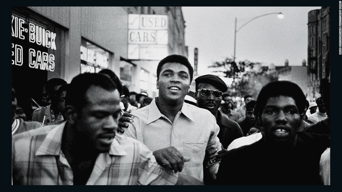 "Ali walks through the streets of New York with members of the Black Panther Party in September 1970. Ali was sentenced to five years in prison for his refusal to enter the draft, and he was also stripped of his boxing title. The U.S. Supreme Court overturned Ali's conviction in 1971, but by that time Ali had already become a figurehead of resistance and a hero to many. <a href=""http://www.cnn.com/2016/06/02/sport/muhammad-ali-three-days/index.html"" target=""_blank"">Related: Photographer fondly recalls his three days with Ali</a>"