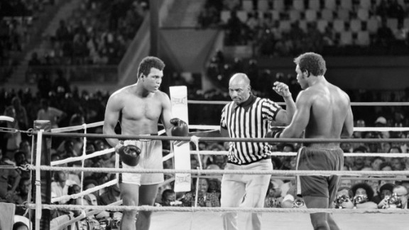 "Ali and Foreman fight October 30, 1974, in what was billed as ""The Rumble in the Jungle."" Ali, a huge underdog, knocked out Foreman in the eighth round to regain the title that was stripped from him in 1967."