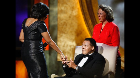Ali's wife, Lonnie, watches as actress Alfre Woodard presents him with the President's Award during the 2009 NAACP Image Awards in Los Angeles.