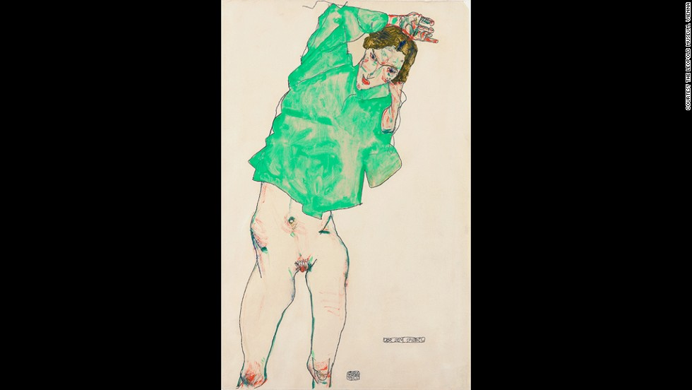 "<em><strong>Standing Nude with Stockings, 1914</strong></em><br /><br />Schiele's desire to show the human body in a different light was heavily influenced by Vienna's artistic and intellectual scene at the beginning of the 20th century. Artists, scientists and poets -- from Gustav Klimt and Oskar Kokoschka to Sigmund Freud -- would congregate in cafés to discuss ideas and identity at a time when the city was rapidly expanding and changing.  <br /> <br />""There was a real cross-fertilization of ideas,"" Wright says. ""In their different ways, they were all seeking to understand something behind the bourgeois official facade ... What they were searching for was a truer account of the human experience, human desire, and human emotions."""