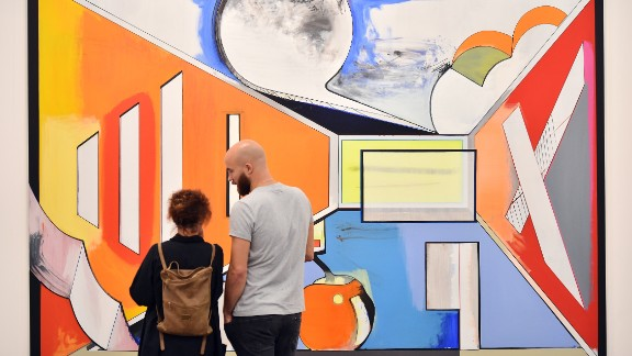 """This artwork is simply studio """"Studio"""". It was painted by the German artist Thomas Scheibitz, and juxtaposes Futurist lines with Fauvist colors."""