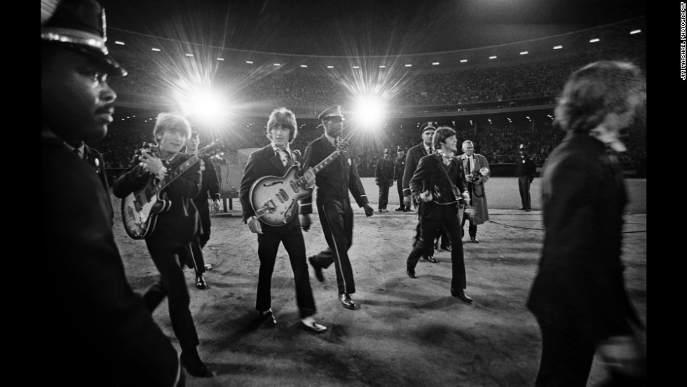 The Beatles performed their last American concert at Candlestick Park in 1966. Marshall caught them both on stage and off.
