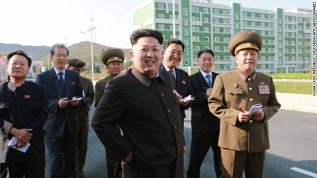 This undated picture released from North Korea's official Korean Central News Agency (KCNA) on October 14, 2014 shows North Korean leader Kim Jong-Un (C) smiling as he inspects a newly-built housing complex in Pyongyang. AFP PHOTO / KCNA via KNS REPUBLIC OF KOREA