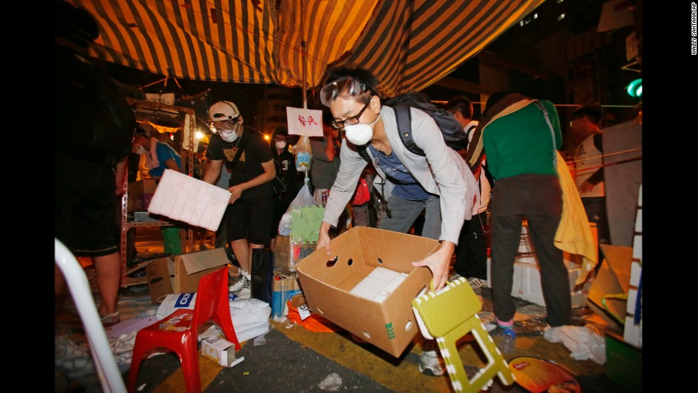 Demonstrators remove their belongings from a protest camp early on October 17.