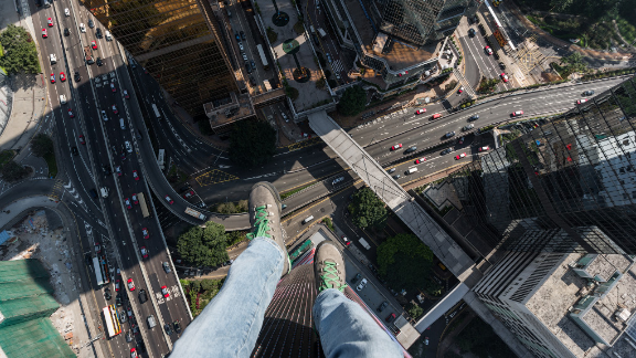 This sort-of selfie, taken by Russian thrillseekers On the Roofs in Hong Kong, would be frowned upon by police in their home country.