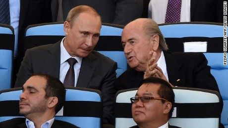 Russian President Vladimir Putin (L) and FIFA President Joseph Blatter attend the 2014 FIFA World Cup final football match between Germany and Argentina at the Maracana Stadium in Rio de Janeiro, Brazil, on July 13, 2014. AFP PHOTO / PEDRO UGARTE (Photo credit should read PEDRO UGARTE/AFP/Getty Images)