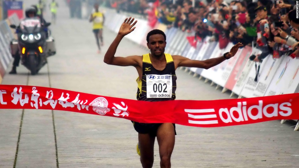 Ethiopia's Girmay Birhanu Gebru takes the finish line in two hours, 10 minutes and 42 seconds at the smog-hit Beijing Marathon.