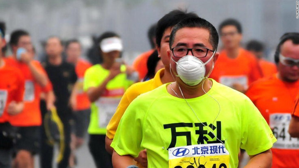 Runners wore face masks and were supplied with thousands of sponges on the course by organizers in the less than ideal conditions for a marathon.
