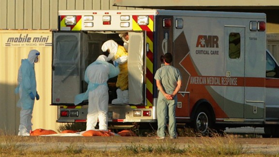 In October, Texas nurse Nina Pham is helped out of the back of an ambulance. She contracted Ebola treating Thomas Eric Duncan. Duncan, a Liberian and the first patient diagnosed with the virus in the United States, died October 8. This case showed the United States how limited its security and its infection-control plan was.