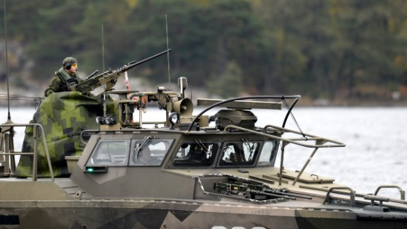 A member of the Swedish military mans a gun on a fast-attack craft on Saturday, October 18.