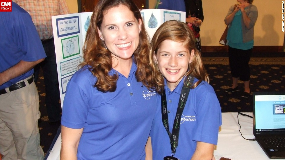"Tomasello and her daughter Catie stand in front of her display at the 2014<a href=""http://www.exploravision.org/"" target=""_blank""> Exploravision awards </a>weekend. ""Catie and her teammates have blown me away with their creativity and desire to use science and technology to help others, and to make the world a better place. Their projects have included an innovative medical device for people with allergies, clean energy for homes and communities, and environmentally friendly methods to desalinate water."" <br /> <br /><br />""A 'proud mom' moment came this summer when Catie explained her team's winning idea, the WateRenew, to a room of over 200 at the National Press Club, packed with corporate officials from Toshiba, including the CEO, educators, scientists, and members of the press. The scientist who created the Wave Wing prototype offered Catie and her teammates each a job upon college graduation with a degree in a science field. Catie is in sixth grade now, but she already has a job waiting for her!"""