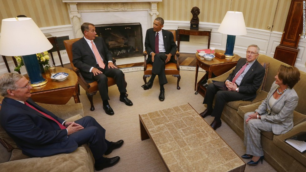 McConnell, far left, attends a meeting in the White House Oval Office with, from right, House Minority Leader Nancy Pelosi, Senate Majority Leader Harry Reid, President Barack Obama and Speaker of the House John Boehner on September 9.