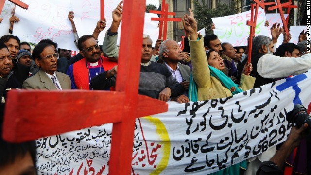 Members of the Pakistan Christian Democratic alliance march during a protest in Lahore on December 25, 2010, in support of Asia Bibi, a Christian mother sentenced to death under blasphemy laws. Arif Ali/AFP/Getty Images)