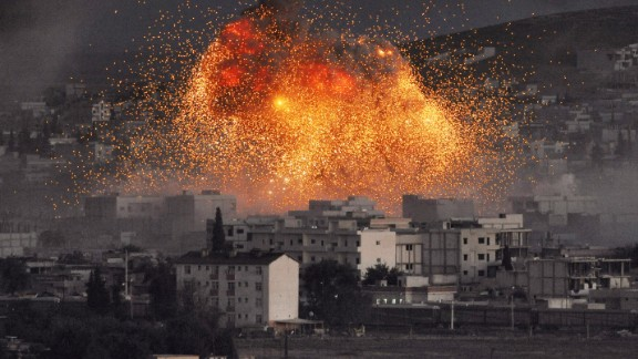 An explosion rocks Kobani, Syria, during a reported car bomb attack by ISIS militants on Tuesday, October 20.