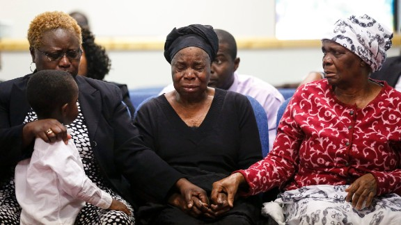 Garteh Korkoryah, center, is comforted during a memorial service for her son, Thomas Eric Duncan, on October 18, 2014, in Salisbury, North Carolina. Duncan, a 42-year-old Liberian citizen, died October 8 in a Dallas hospital. He was in the country to visit his son and his son's mother, and he was the first person in the United States to be diagnosed with Ebola.