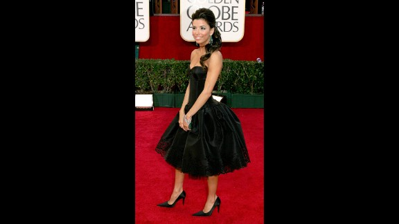 "This kicky black de la Renta dress, worn to the 2005 Golden Globes, is one of Eva Longoria's most memorable red-carpet looks. The actress was starring on ""Desperate Housewives"" at the time, and her impeccably detailed cocktail number was like the luxe item a '50s housewife would kill to add to her collection."
