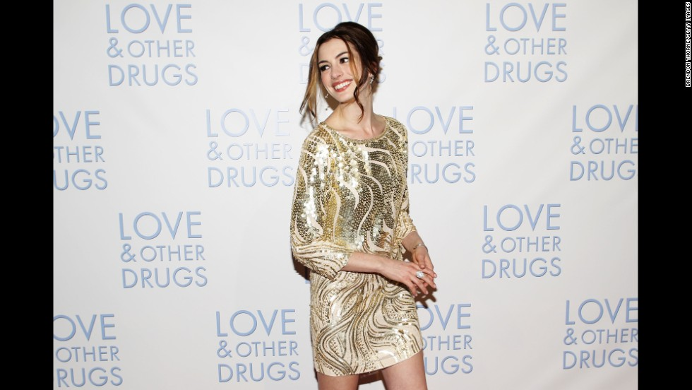 "While de la Renta was known for his show-stopping dresses with full skirts or elongated trains, he could also make a simple shift sing. Anne Hathaway wore this short, breezy and sparkling de la Renta number to the Sydney premiere of ""Love & Other Drugs"" in 2010."