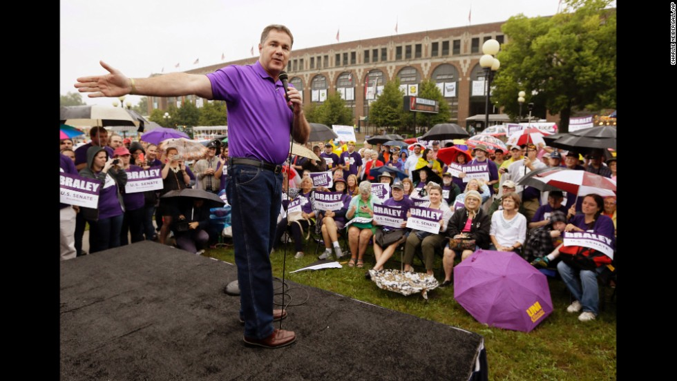 Braley talks to fairgoers in August at the Iowa State Fair in Des Moines. With just weeks left in the race, the congressman brought in high-profile campaigners such as first lady Michelle Obama.