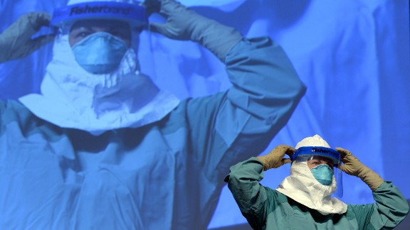 A nurse at Mount Sinai Health Systems in New York demonstrates the proper technique for donning and removing protective gear. The Centers for Disease Control and Prevention updated its protective gear and disease-management protocols. It also sent out guidance to help frightened Americans better understand that the virus was unlikely to get them in their homes.