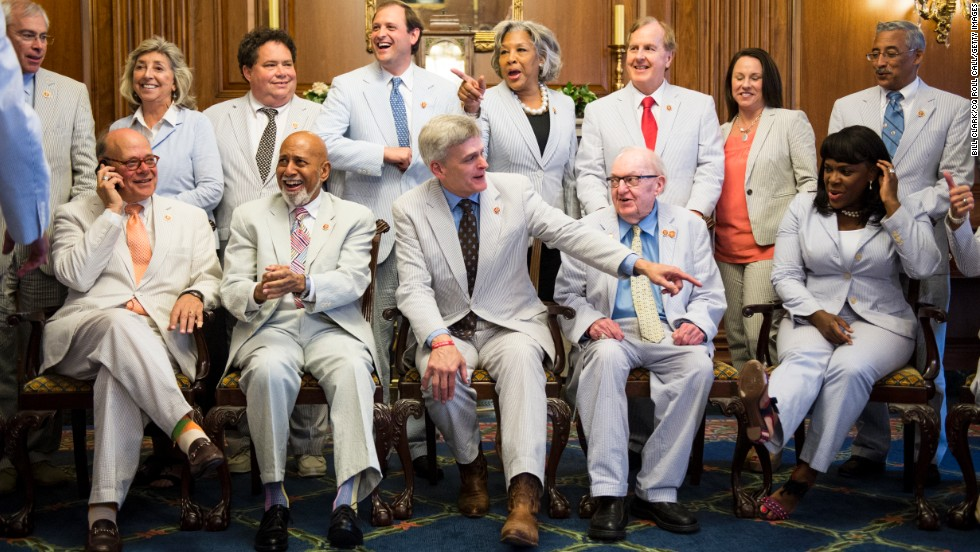 Cassidy, center, admires the seersucker outfits of his fellow Congress members on June 11.