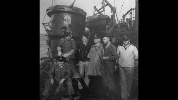 Crew members gather around an 88mm gun.