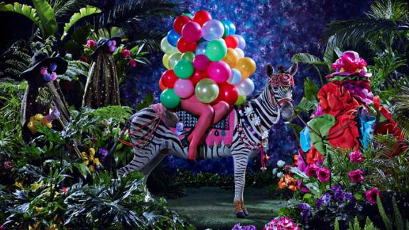 """""""The Night of the Long Knives I"""", 2013. The world of Azania is depicted as a tropical idyll with lush vegetation. Its ballooned """"white woman"""" rides on the back of a zebra."""