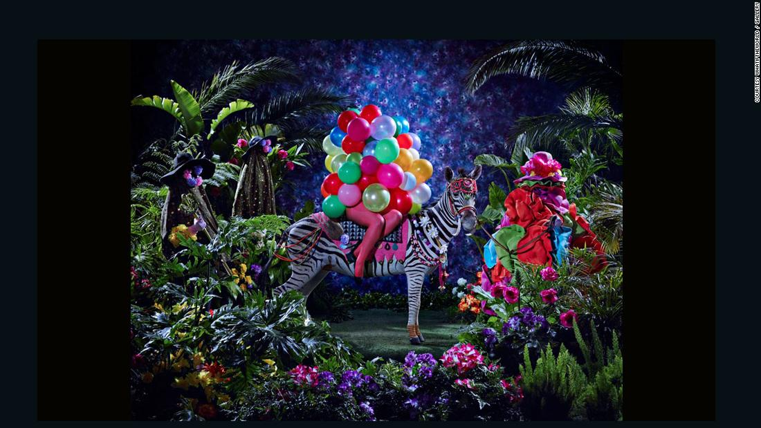 """The Night of the Long Knives I"", 2013. The world of Azania is depicted as a tropical idyll with lush vegetation. Its ballooned ""white woman"" rides on the back of a zebra."
