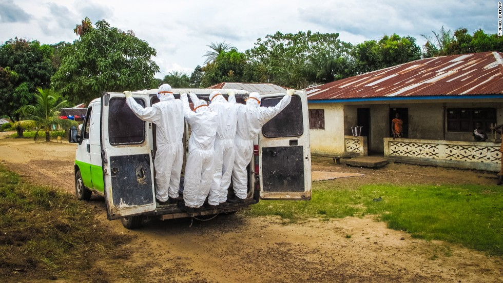 Health workers in Port Loko, Sierra Leone, transport the body of a person who is suspected to have died of Ebola on October 21, 2014.