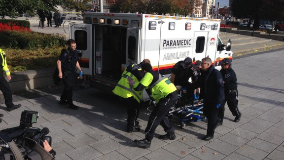 Police and paramedics transport a wounded Canadian soldier on Wednesday, October 22, in Ottawa, Canada.