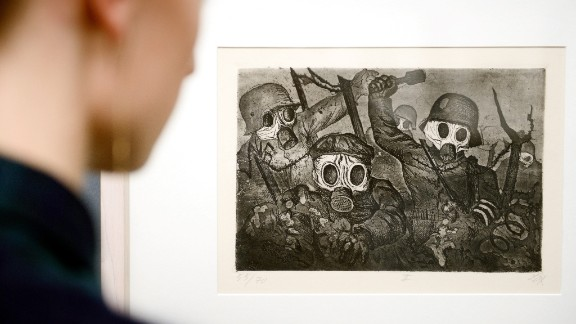 "Victorian imagery was inadequate to express World War I's anxieties, so new experiments took up the task, with artists incorporating aggressive imagery of combat and its ruinous consequences. Here a visitor to the Kunstmuseum in Stuttgart, Germany, examines Otto Dix's 1924 ""Storm Troopers Advancing Under Gas."""