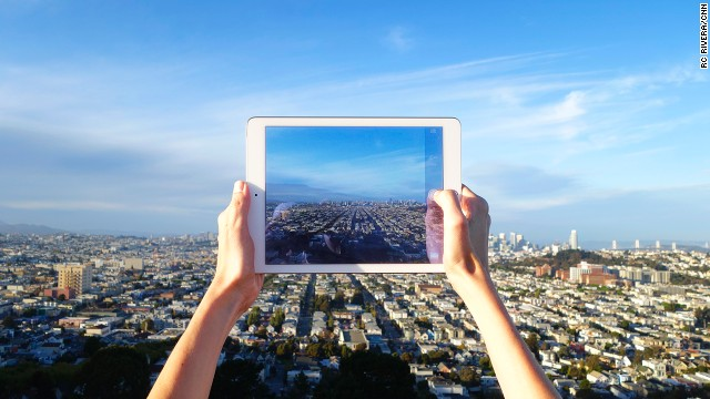 An  Apple iPad Air 2 user takes a photo of San Francisco from Bernal Heights.