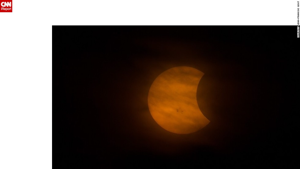 "Gout attached his camera to a telescope to create this <a href=""http://ireport.cnn.com/docs/DOC-1182676"">up-close shot </a>of the partial solar eclipse."