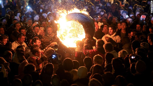 A burning barrel soaked in tar is carried through the crowds at the annual Ottery St Mary Tar Barrel festival on November 5 2013 in Ottery St Mary, Devon, England.