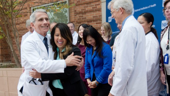 Dr. Anthony Fauci, director of the National Institute of Allergy and Infectious Diseases, hugs Nina Pham outside the National Institutes of Health in Bethesda, Maryland.