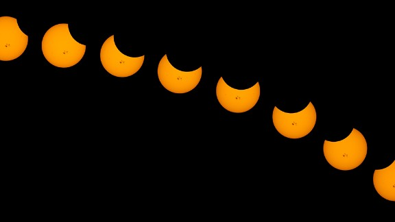 "The moon took a small bite out of the sun in a partial solar eclipse on Thursday. People throughout the U.S. shared their photos with CNN iReport. Jim Steel created a time-lapse composite after snapping photos for more than two hours in Weldon, California. ""The massive sunspots made this the most interesting solar shots I have ever made,"" he said."