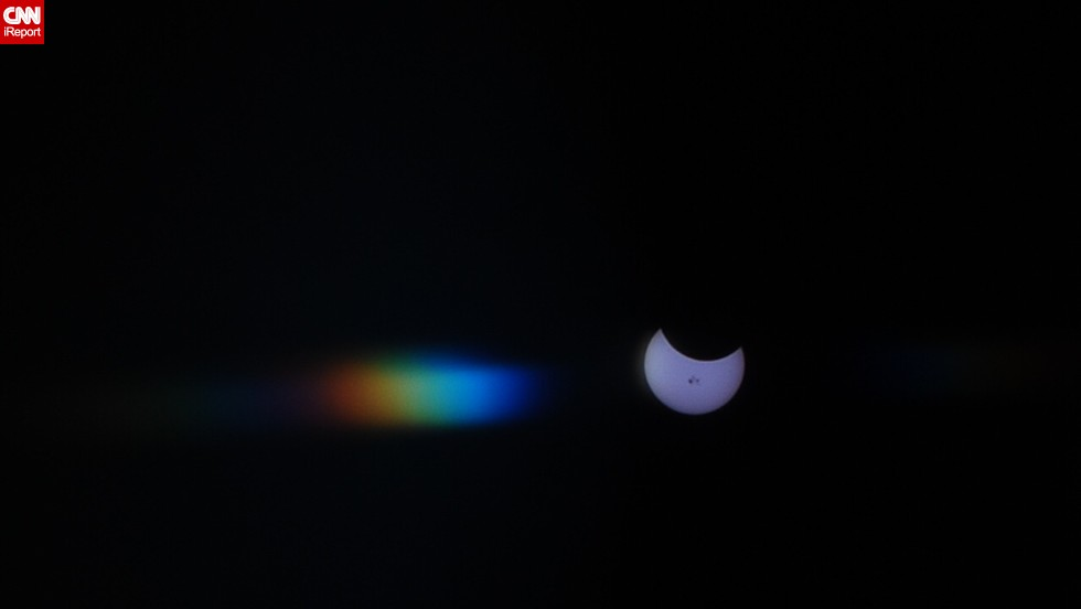 "Yucca Valley, California, resident <a href=""http://ireport.cnn.com/docs/DOC-1182471"">Angela Wright</a> used layers of X-ray film to photograph the partial solar eclipse, which resulted in this prism effect."