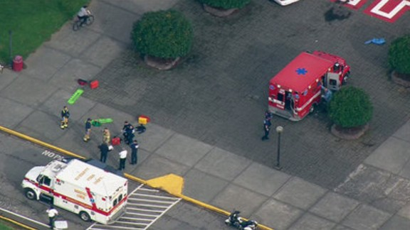 Emergency personnel respond to the school after the shooting.