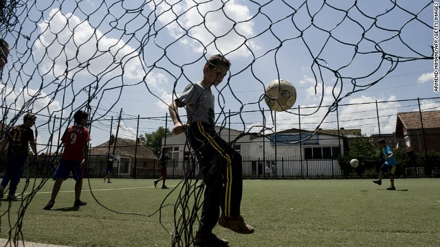 Boys enjoy playing football in Kosovo on June 29, 2014. But some parents place undue pressure on their aspiring footballers.