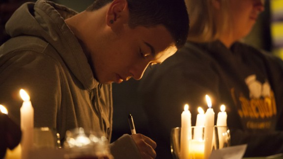 Students from Marysville-Pilchuck High School write messages and prayers during a vigil Friday, October 24, at a church in Marysville, Washington. Earlier in the day, a student shot five people at the school before he committed suicide, law enforcement officials told CNN.
