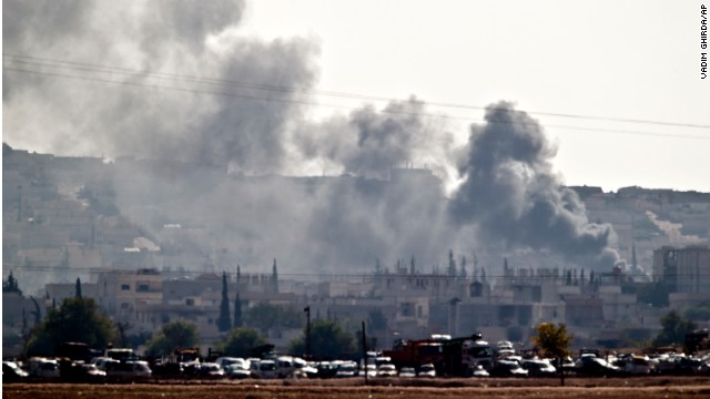Smoke rises during fighting in Kobani, seen from the outskirts of Suruc, near the Turkey-Syria border, Saturday, October 25.