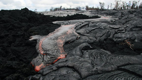 Lava flows from the Kilauea volcano in Pahoa, Hawaii, in October 2014. The flow picked up speed, prompting emergency officials to close part of the main road through town and tell residents to be prepared to evacuate.