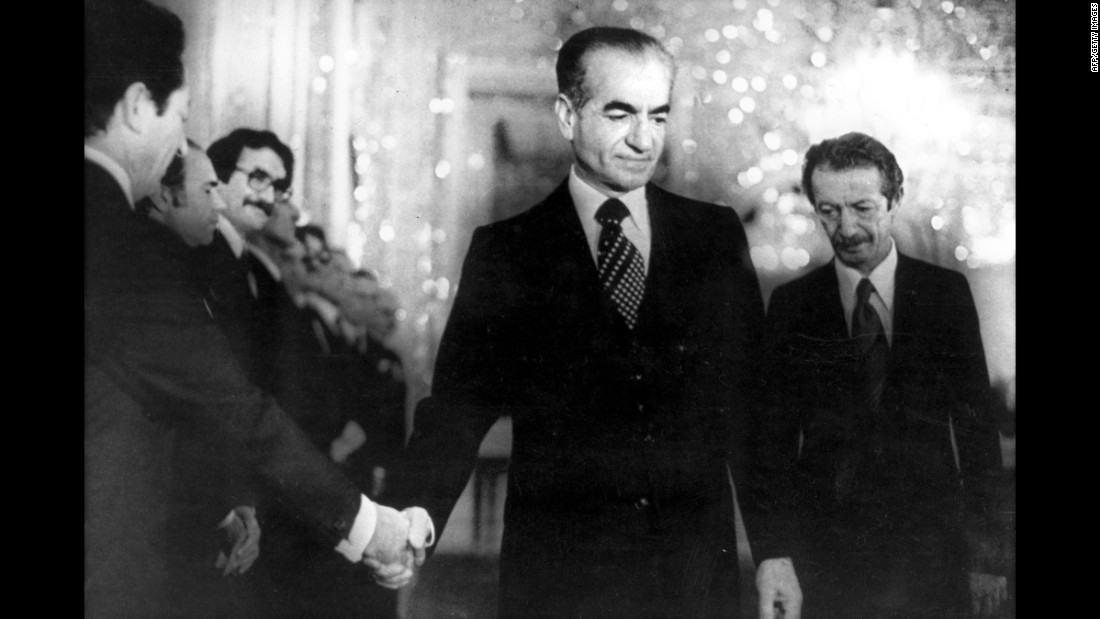 The Shah shakes hands with a minister of the new civilian government in Tehran on January 6, 1979. Ten days later, he fled the country and headed to Egypt.