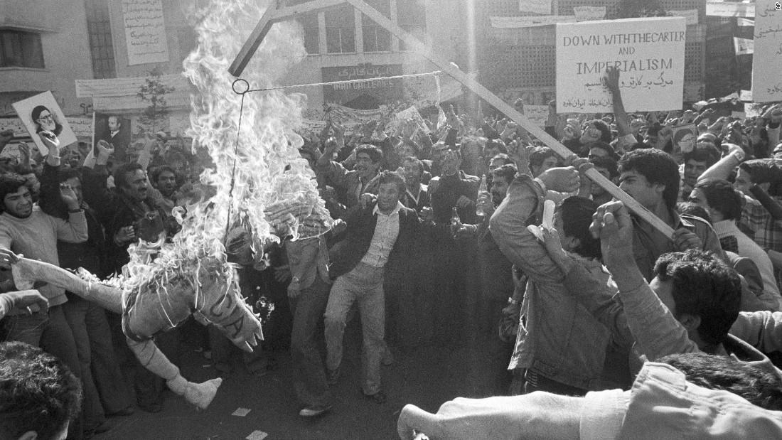 "Demonstrators burn an effigy of Uncle Sam outside the U.S. Embassy in Tehran on November 13, 1979. They had gathered to show support for the Iranian militants who took over the embassy. The effigy was branded with ""CIA"" on its arm."