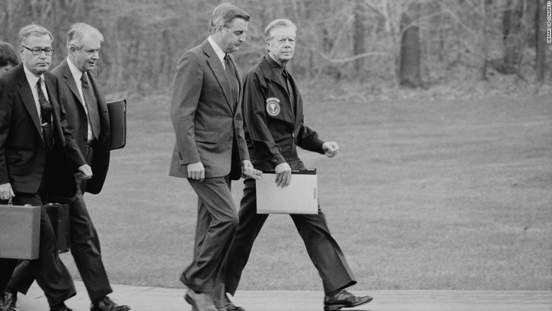 From right, President Jimmy Carter, Vice President Walter Mondale, Secretary of State Cyrus Vance and Secretary of Defense Harold Brown disembark from their helicopter to meet about the Iran hostage crisis at Camp David in Maryland on November 23, 1979. Carter ordered Iranian assets in U.S. banks frozen and eventually cut diplomatic ties with Iran.