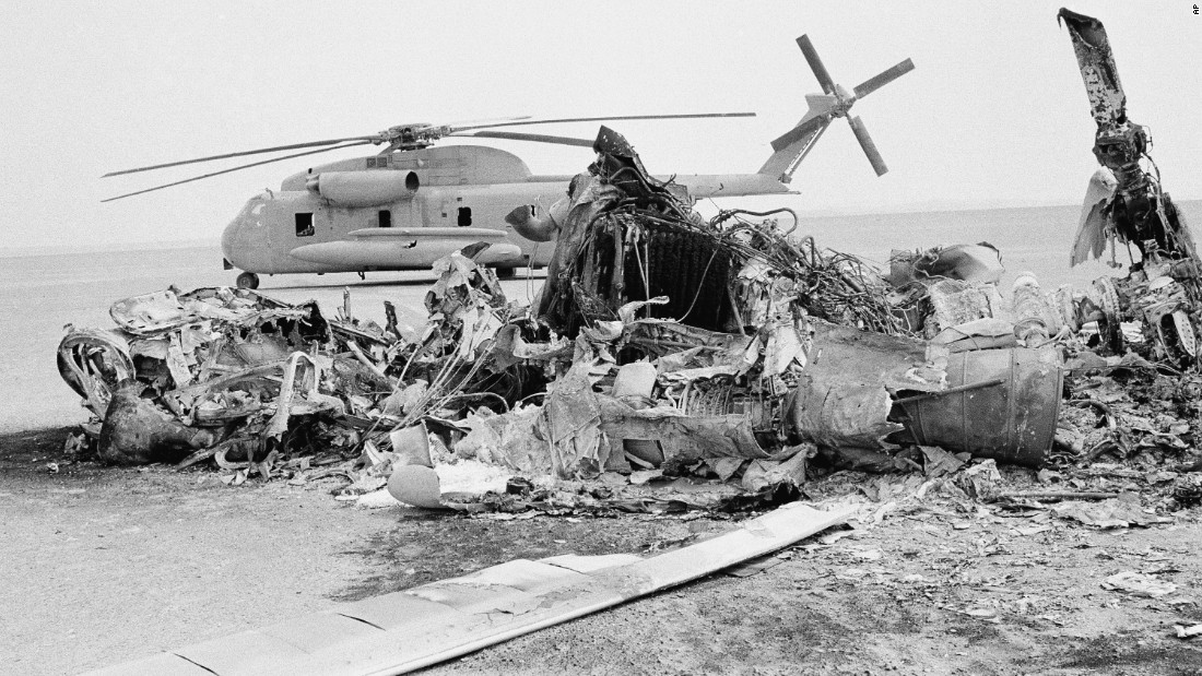 Remains of a burned-out American helicopter are seen in front of an abandoned chopper in the eastern desert of Iran in April 1980. Eight U.S. servicemen were killed when a helicopter and a transport plane collided during a failed attempt to rescue the hostages.