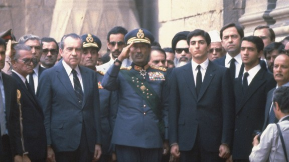 Former U.S. President Richard Nixon stands with Sadat, center, and Iranian Crown Prince Reza at the Shah