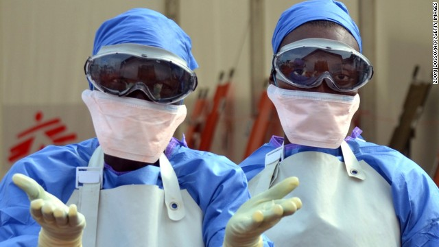 Liberian health workers are seen at the NGO Medecins Sans Frontieres (Doctors Without Borders) Ebola treatment center in Monrovia, on October 18, 2014. The death toll in the world's worst-ever Ebola outbreak has shot past 4,500, killing at least half of the more than 9,000 people infected, fresh World Health Organization figures showed on October 17. AFP PHOTO / ZOOM DOSSO (Photo credit should read ZOOM DOSSO/AFP/Getty Images)